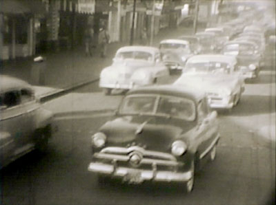 Automobiles file out of downtown Mobile in the 1954 Civil Defense exercise Operation Scat.