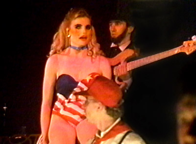 Mariel Hemingway singing as a member of a guerilla resistance theater troupe in AMERIKA