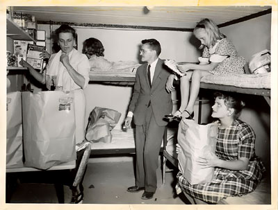 An unidentified family prepares its fallout shelter...