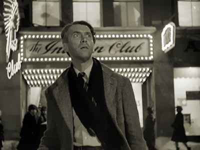 IT'S A WONDERFUL LIFE - Jimmy Stewart in front of the Indian Club in Pottersville